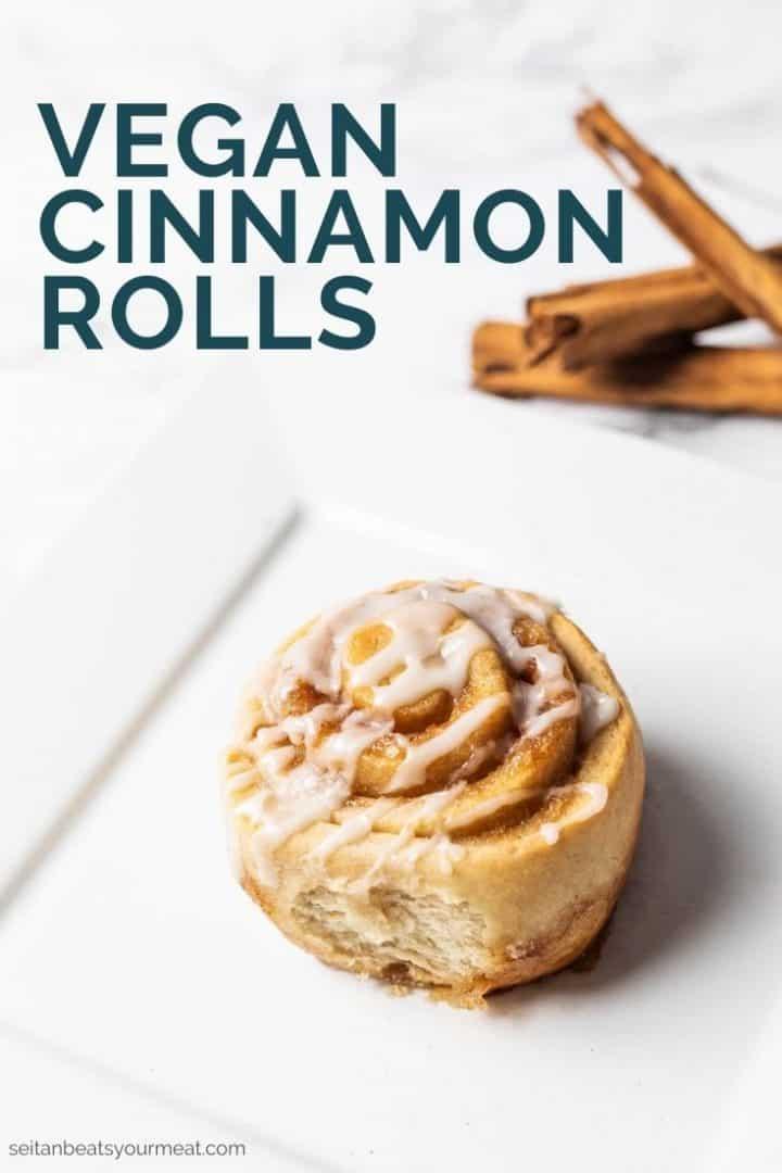 "Cinnamon roll on plate with text ""vegan cinnamon rolls"""