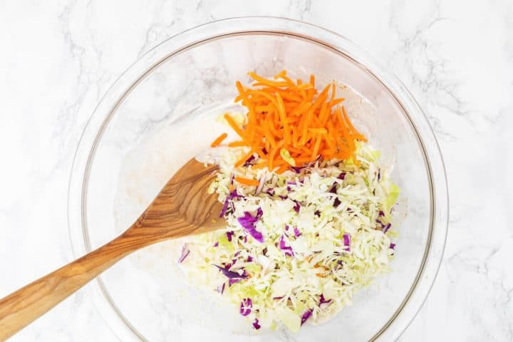 Shredded cabbage and carrots in a large bowl