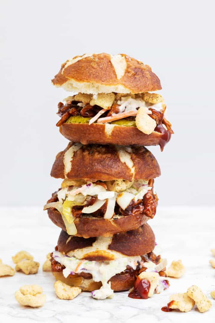 Tall stack of 3 pulled pork sandwiches on marble counter