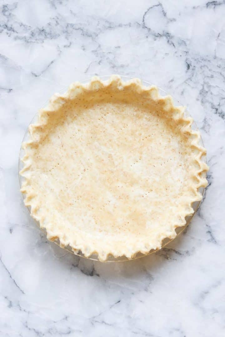 Prepared pie crust on marble counter
