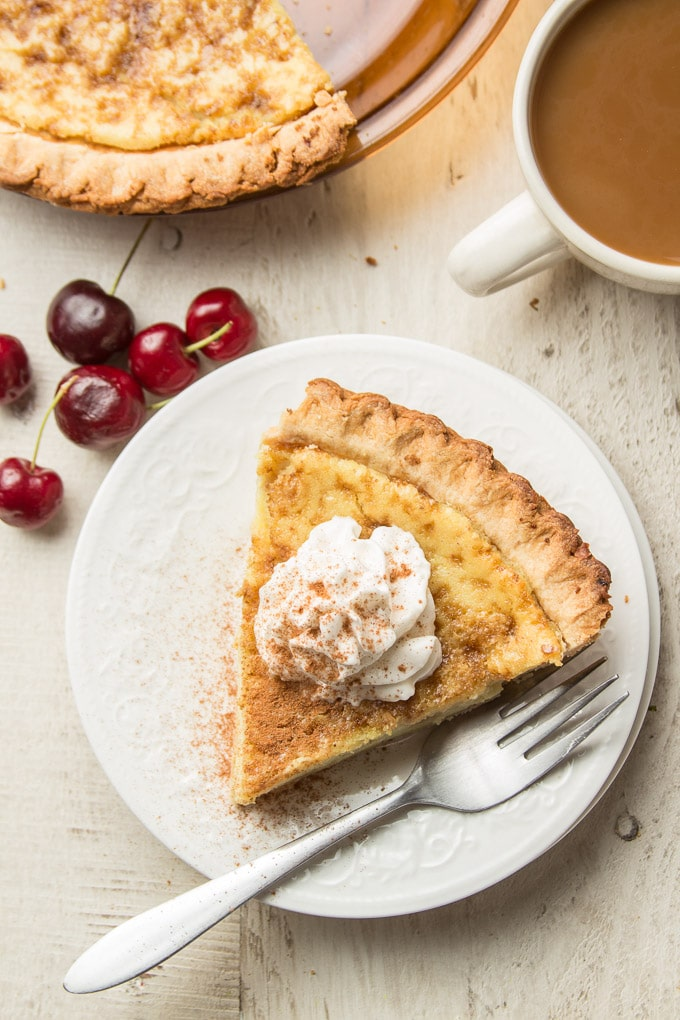 Custard pie on plate with cherries