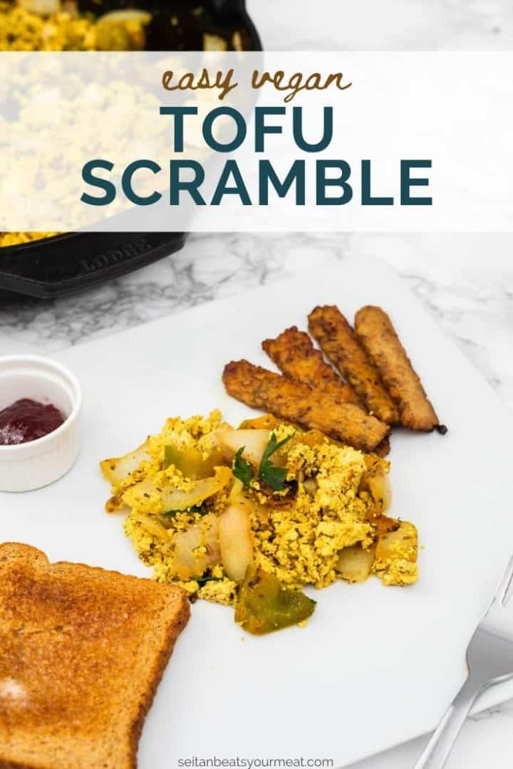 """Plate of tofu scramble with tempeh bacon and toast with text """"Easy Vegan Tofu Scramble"""""""