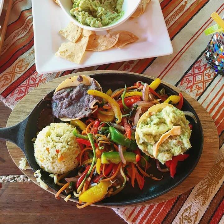 Plate of veggie fajitas and guacamole