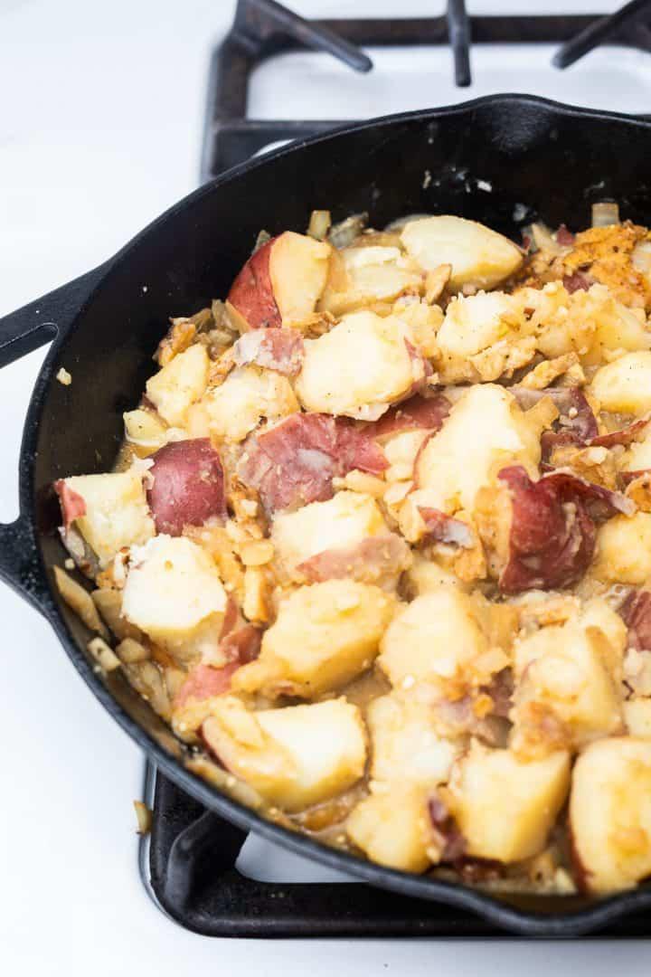 German potato salad in cast iron pan on stove