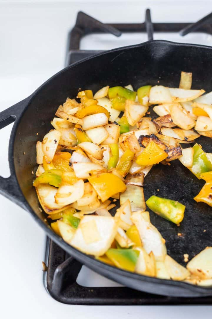 Peppers and onions in cast iron pan