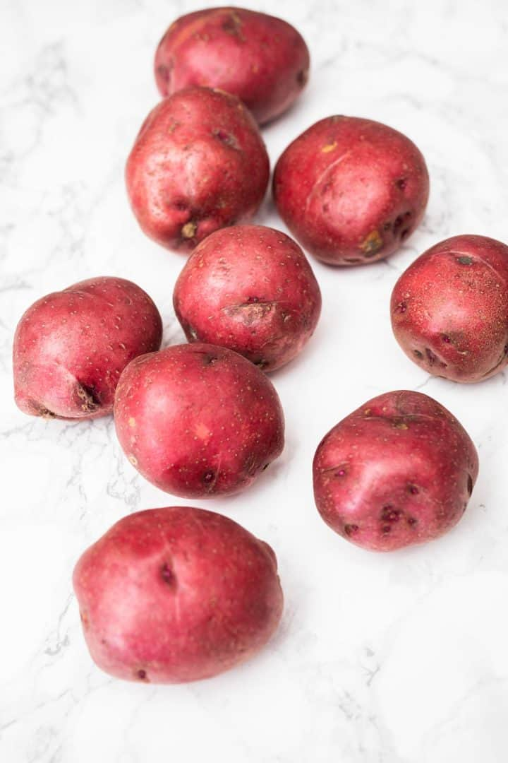 Red potatoes on marble counter