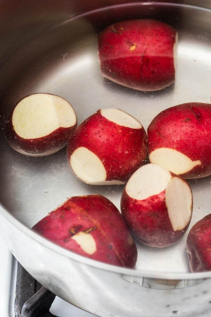 Red potatoes in large pot of water on stove