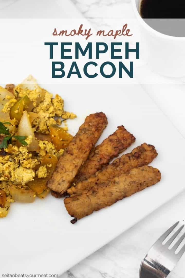 """Plate of tofu scramble and tempeh bacon with text """"Smoky Maple Tempeh Bacon"""""""
