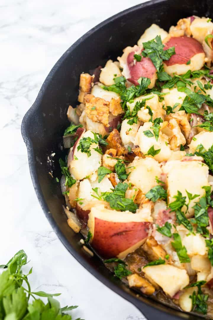 German potato salad in cast iron pan with parsley