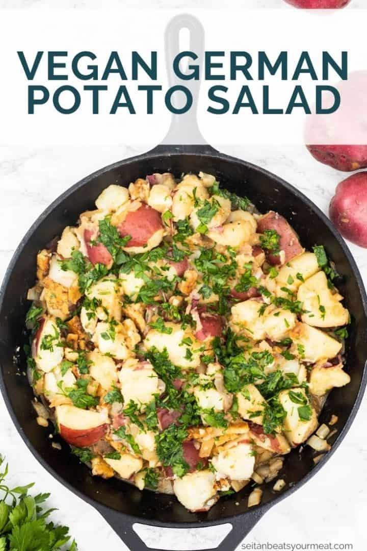"""German potato salad in cast iron pan with text """"Vegan German Potato Salad"""""""