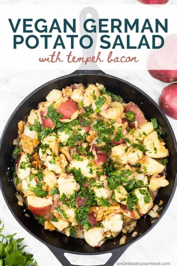 """German potato salad in cast iron pan with text """"Vegan German Potato Salad with tempeh bacon"""""""