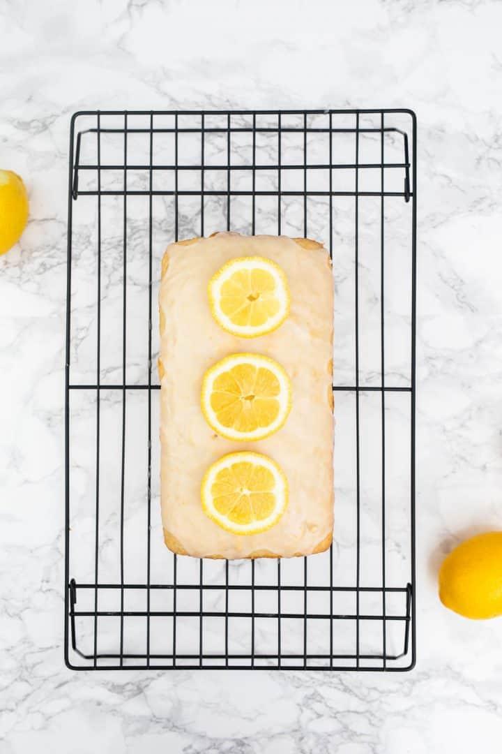 Glazed lemon loaf on cooling rack