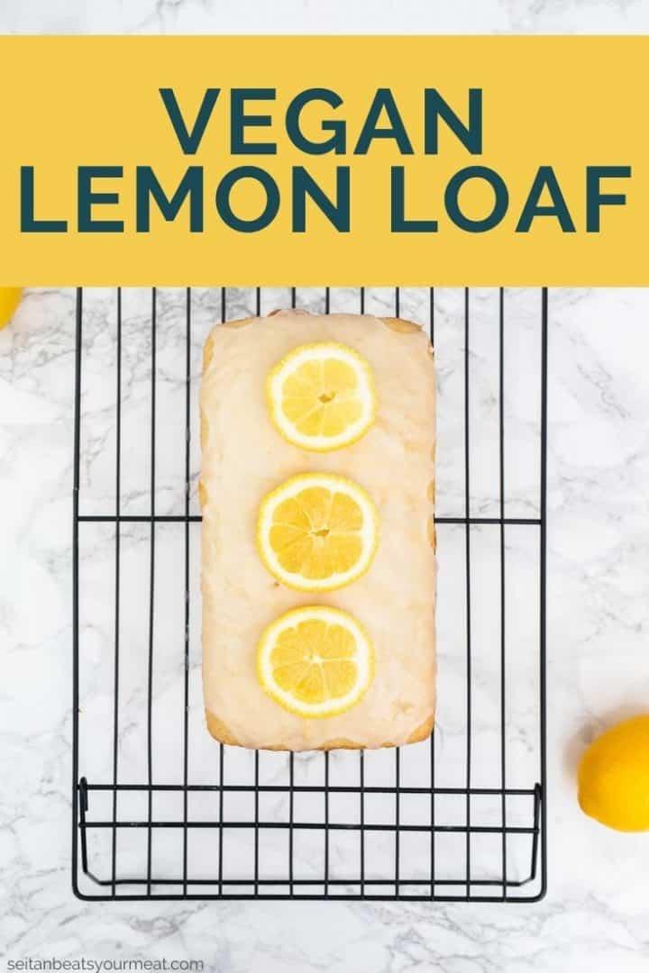 """Glazed lemon loaf on cooling rack with text """"Vegan Lemon Loaf"""""""