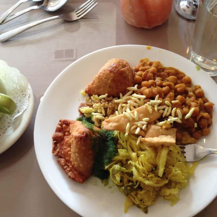 Plate of vegan Indian food at restaurant
