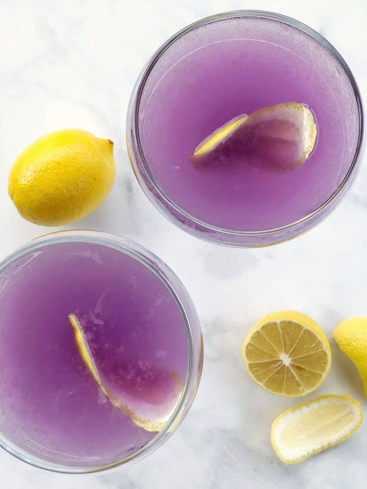 Purple gin cocktails with fresh lemons
