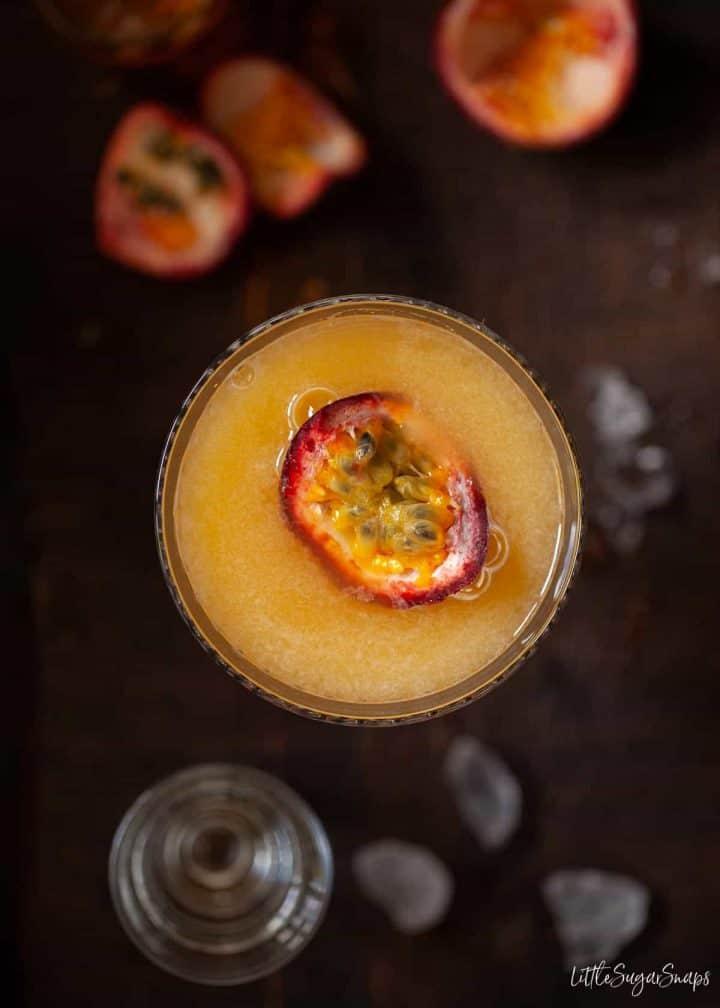Passionfruit martini overhead on wood table