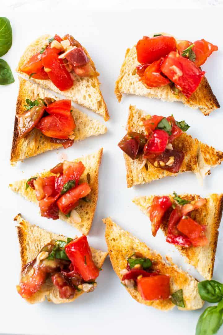 Tomato bruschetta on toast pieces on plate