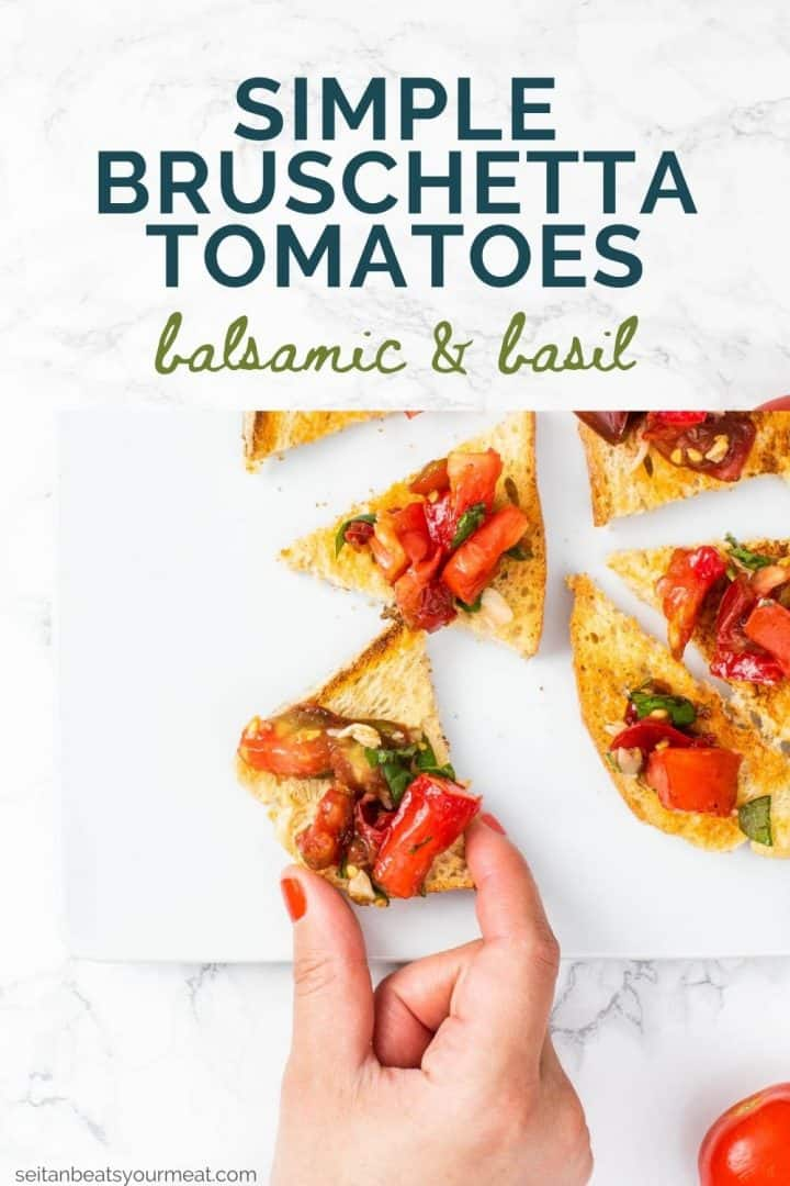 """Hand reaching for piece of toast with tomato bruschetta and text """"Simple Bruschetta Tomatoes balsamic & basil"""""""