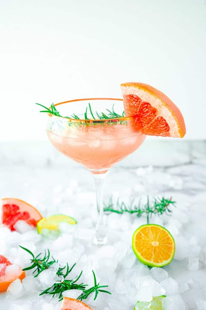 Grapefruit and rosemary cocktail on bed of ice