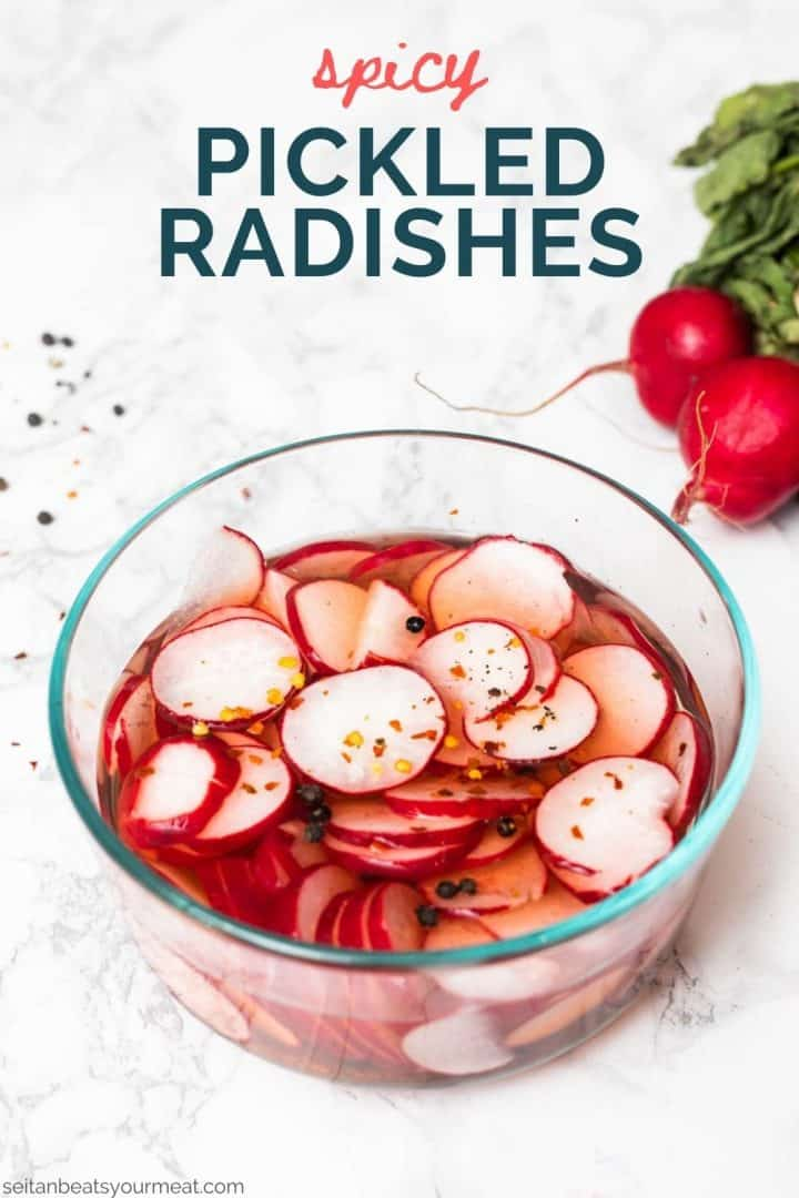 """Glass bowl filled with radish slices in brine with text """"spicy pickled radishes"""""""