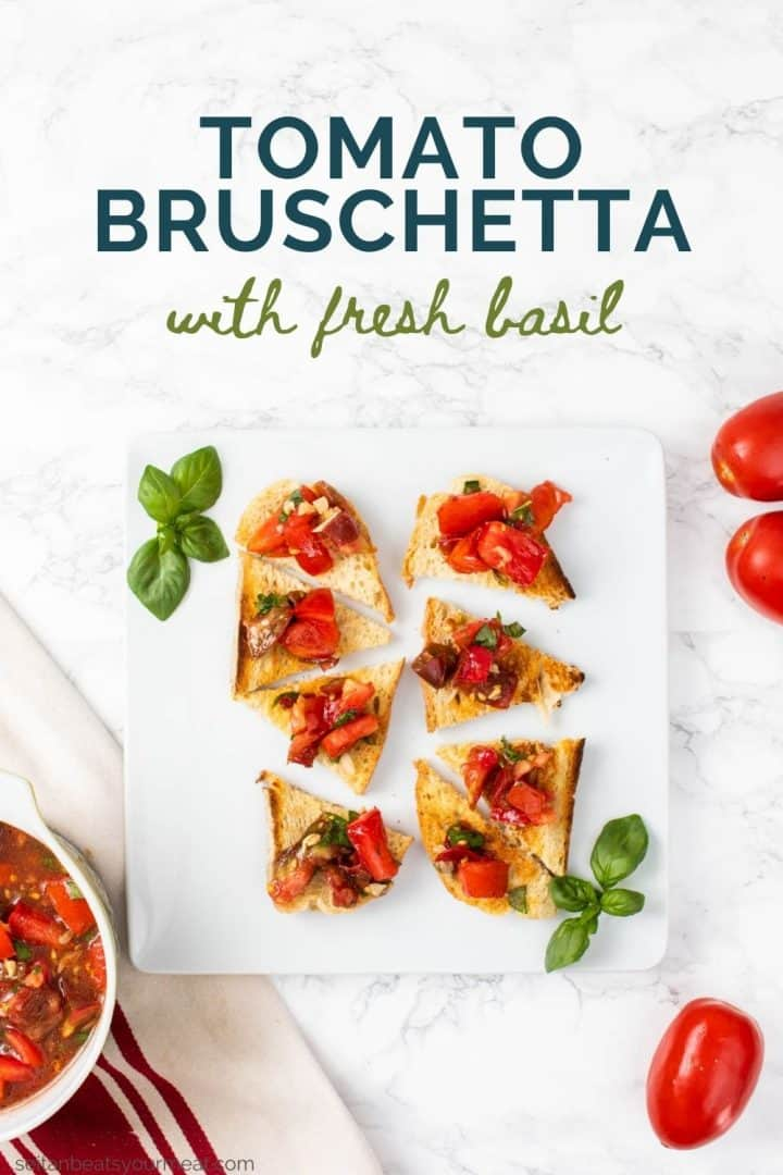 """Pieces of toast with tomato bruschetta and text """"Tomato Bruschetta with Fresh Basil"""""""
