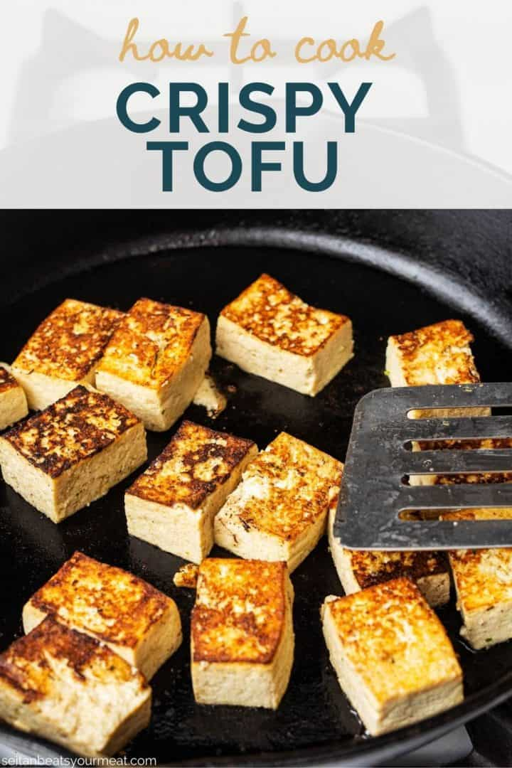 """Browned tofu cubes in cast iron pan with text """"How to Cook Crispy Tofu"""""""