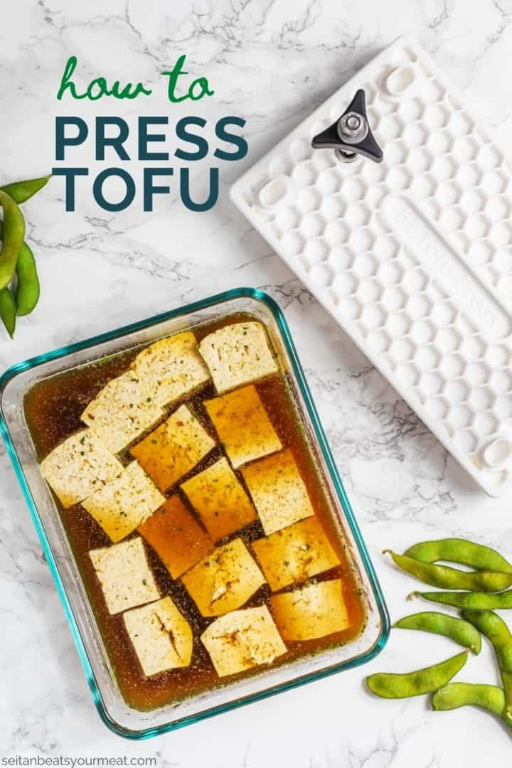 """Tofu cubes marinating in dish with tofu press off to side and text """"How to Press Tofu"""""""