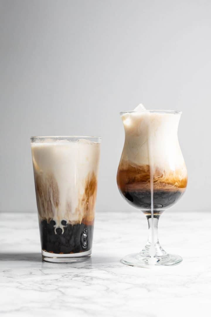 Two glasses filled with brown sugar boba tea