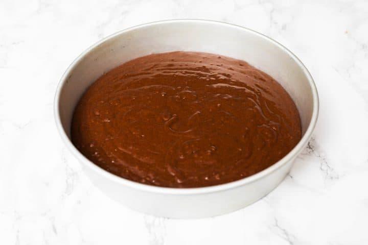 Vegan chocolate cake batter in cake pan on counter