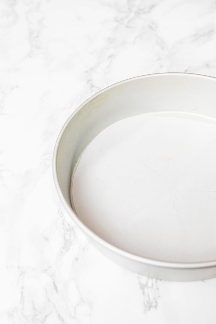 Parchment paper liner in cake pan on counter