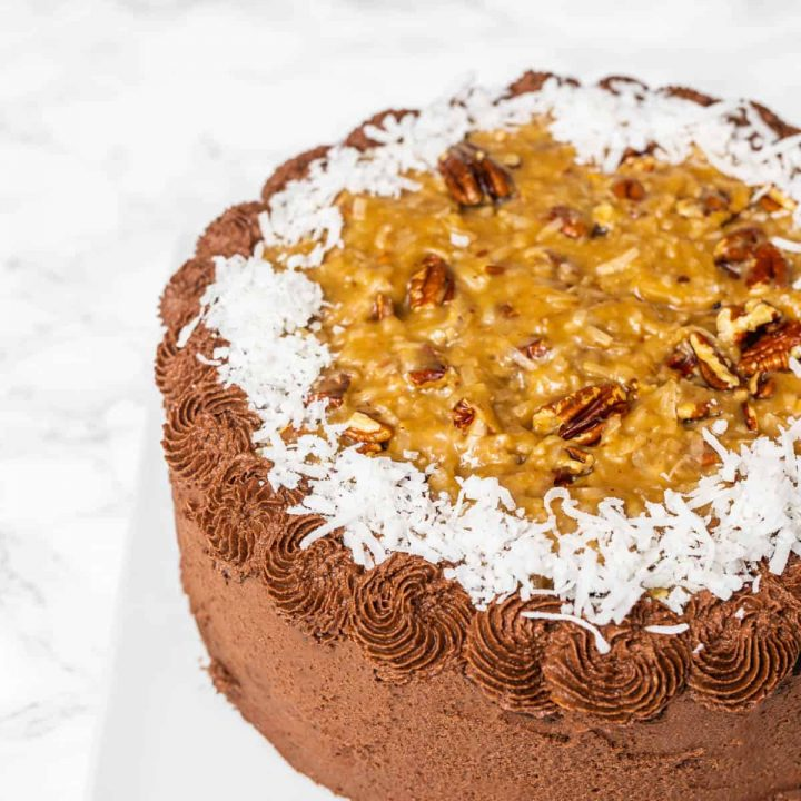 German chocolate cake on white plate on white marble counter