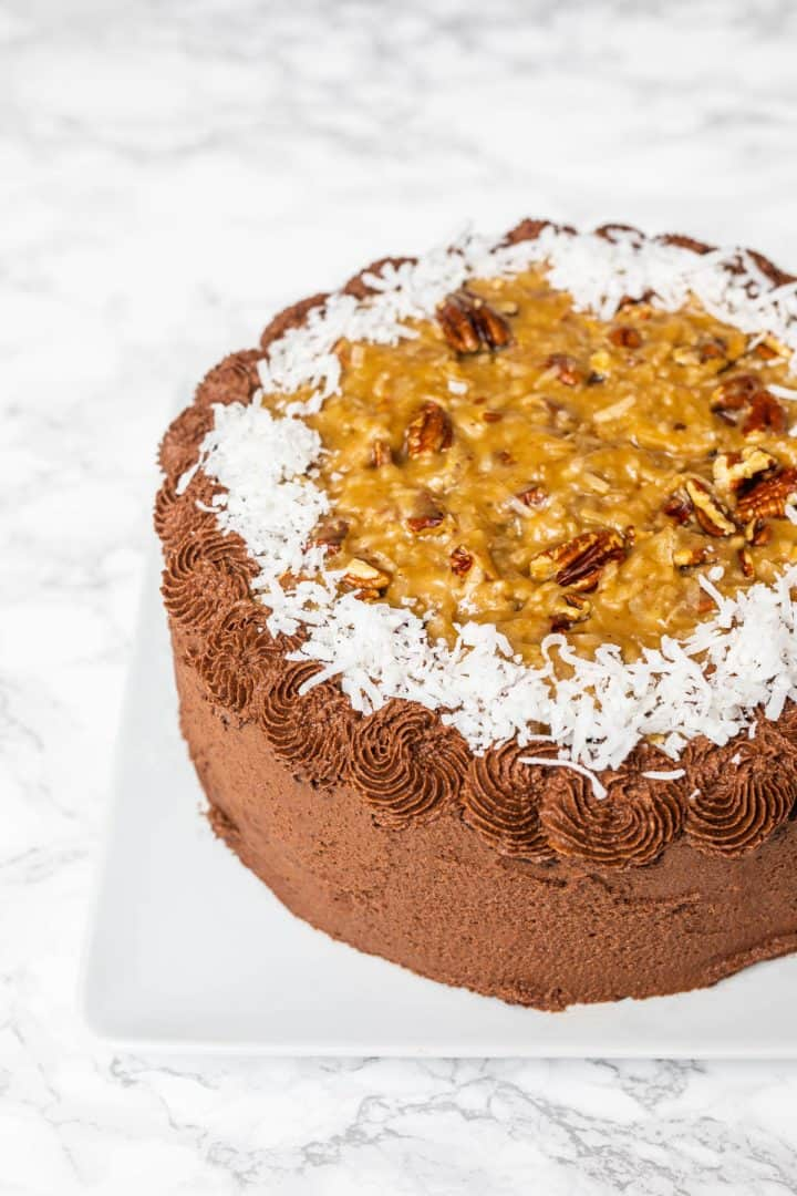 German chocolate cake on plate on marble counter