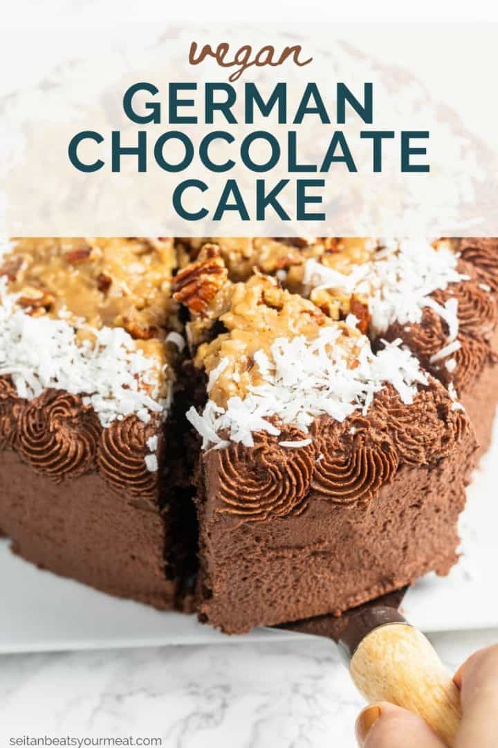 """Hand lifting slice of chocolate cake with pecan coconut caramel and chocolate frosting with serving utensil with text """"Vegan German Chocolate Cake"""""""
