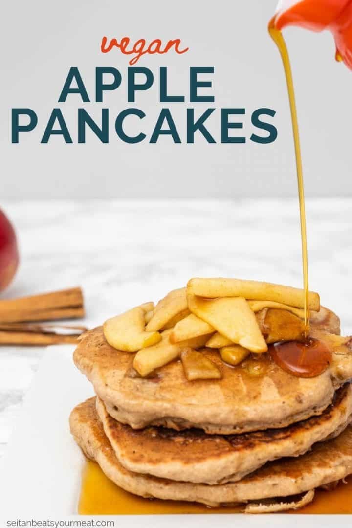 """Stream of syrup pouring on plate of pancakes topped with cooked apples with text """"Vegan Apple Pancakes"""""""