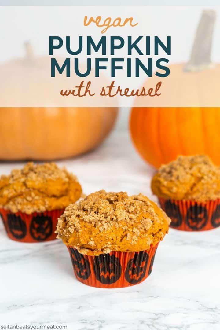 "Three pumpkin muffins on table with pumpkins and text ""Vegan Pumpkin Muffins"""