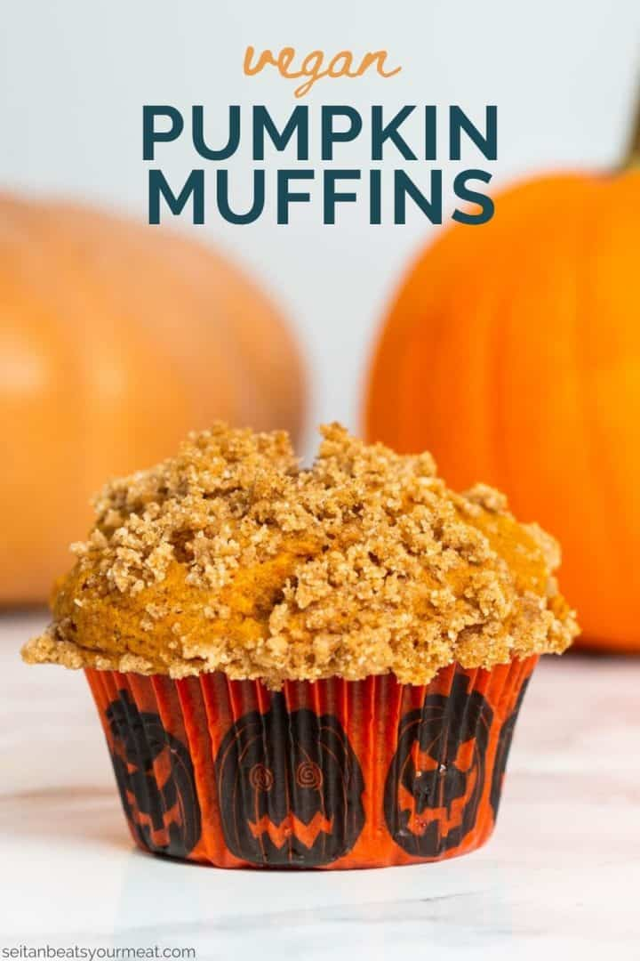 """Close up of pumpkin muffin with pumpkins in background with text """"Vegan Pumpkin Muffins"""""""